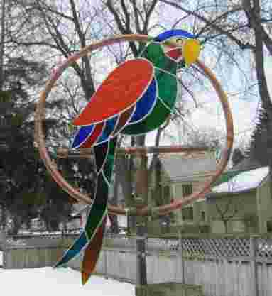 stained glass parrot bird in copper sprinkler